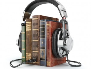 Audiobooks concept. Vintage books and headphones.